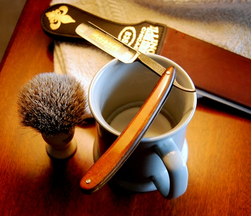 This is my son Matt's straight razor and shaving cup, soap, brush and strop.  He says that using a straight razor produces a cheaper and better shave, although it takes three times longer than with an electric razor.