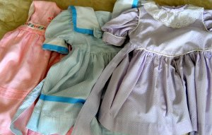 These dresses are survivors from my sewing frenzy when my daughter was about two.  The rest were handed down -- those that weren't stained or torn -- to nieces.