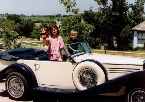 Many years ago, my husband built this Classic Roadsters kit version of a 1936 Mercedes Benz.  He said it was fun to build and to drive around.  We sold it when the kids were getting ready to drive.  We needed more practical cars.  Here are my daughter and son, years ago, waiting for a spin in the cool car.
