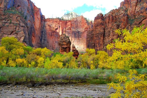 """The """"pulpit"""" on the left and the """"altar"""" on the right are natural rock monuments in the Temple of Sinawava at the end of the road in Zion Canyon.  A riverside trail continues along the Virgin River until the cliffs narrow and further hiking has to be done in the water."""