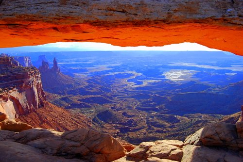 Mesa Arch glows just after sunrise in the Island in the Sky section of Canyonlands National Park, Utah.