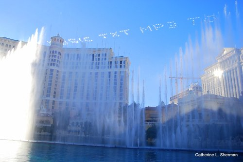 This is a Las Vegas version of a fountain -- over the top.  Five small airplanes write in the sky at the beginning of an afternoon water show in the lagoon in front of the Bellagio Hotel.