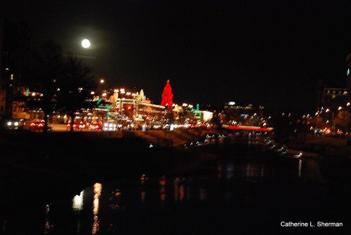 The full moon hung like a huge ornament over the Christmas lights of the Country Club Plaza shopping center in Kansas City.