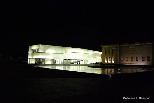 You can't see the moon here, but the Bloch Building creates its own glow.  The Bloch, a new addition to the Nelson Atkins Museum of Art, houses contemporary art.