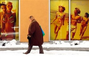 You need sunshine, but not as much as the people in the posters are getting.  This woman is probably getting enough as she walks past posters on a tanning salon while walking from her home in the Seattle area to the grocery store on Dec. 22, 2008.  (AP Photo/Seattle Post-Intelligencer,  Andy Rogers)