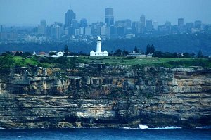 This aerial view of Macquarie Lighthouse shows the Sydney skyline in the background.  The lighthouse stands on the south head of Sydney Harbor. This isn't my photograph, though I wish it were!
