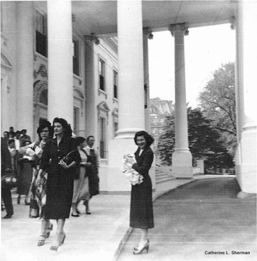 My mother is holding me outside the White House in the 1950s.  Look how stylishly everyone is dressed.