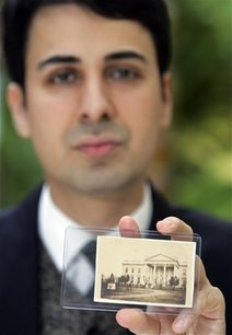 Photography collector Keya Morgan holds what he believes is a rare, unpublished photograph of Abraham Lincoln, the only image of the 16th president in front of the White House and the last sitting of Lincoln in 1865 before he died, in Beverly Hills, Calif., Friday, March 6, 2009.  The image by photographer Henry F. Warren was uncovered in the personal album of Gen. Ulysses S. Grant.  (AP Photo/Reed Saxon)