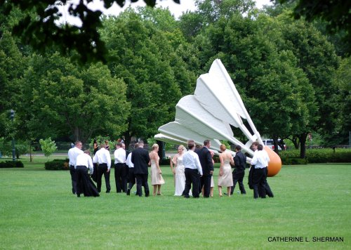 Wedding parties often arrive on the front lawn of the Nelson-Atkins Museum of art to be photographed in front of the shuttlecocks.  In fact, I don't think you're officially married in Kansas CIty until you make this ritual visit with your bridesmaids and groomsmen.