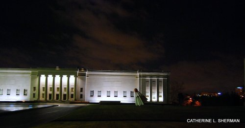 A shuttlecock adorns the front of the Nelson-Atkins Museum of Art in this dramatic night view.