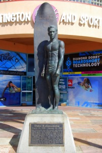 Duke Kahanamoku, the father of modern surfing, is honored with a statue near the Surfing Walk of Fame at the pier plaza in Huntington Beach, California.