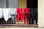 Wetsuits drying at a motel.