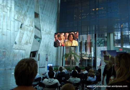 On January 21, 2009, in Federation Square in Melbourne, Australia, people gather to watch a re-broadcast of Barack Obama's take the oath of office to become the President of the United States.