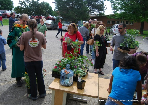 People wait in line to buy their plants at the 2012 Monarch Watch annual Spring open house and plant sale.