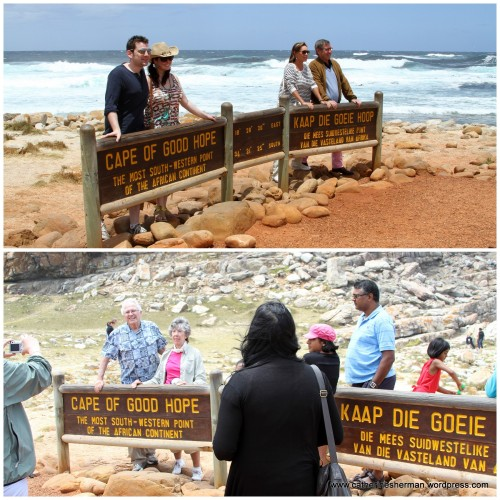 There's a traffic jam at the Cape of Good Hope sign as people wait to get their photos taken at this landmark.