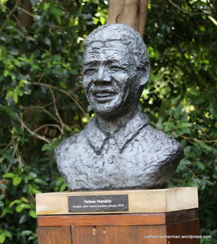 This sculpture of Nelson Mandela is in Kirstenbosch National Botanical Garden, which is on the eastern slopes of Cape Town's Table Mountain in South Africa.  Mandela is considered a national treasure and is featured in art and sculpture throughout South Africa.  Kirstenbosch, established in 1913, was the first botanic garden in the world to be devoted to a country's indigenous flora.