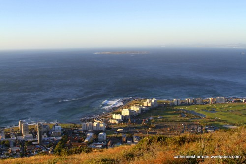 From Signal Hill, you can see Robben Island near the horizon, in Table Bay off the coast of Cape Town, South Africa. Nelson Mandela was imprisoned for eighteen years on Robben Island.