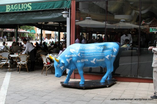 This blue cow advertises the Peacemakers Museum, which celebrates the Nobel Peace Laureates but in particular South Africa's Albert Luthuli, Desmond Tutu, FW de Klerk and Nelson Mandela.  The museum is in Nelson Mandela Square, Johannesburg.   http://www.peacemakersmuseum.co.za/