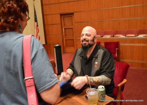 "After his talk in Kansas City, Jackson Galaxy signed copies of his book ""Cat Daddy: What the World's Most Incorrigible Cat Taught Me About Life, Love, and Coming Clean."""