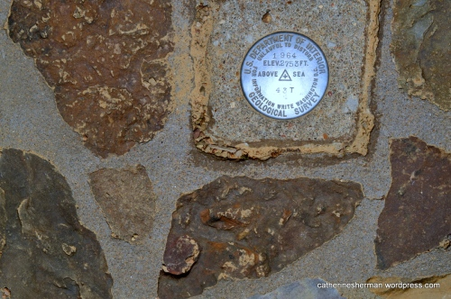 This survey marker plaque on Signal Hill of Mount Magazine from the U.S. Department of Interior indicates the highest point in Arkansas (2,753 feet above sea level) and sits in a 400 square feet stone map of Arkansas.  The stone map was built to a scale of one foot equals 13 miles.  On the stone map, the survey marker is positioned on the location of Mount Magazine.