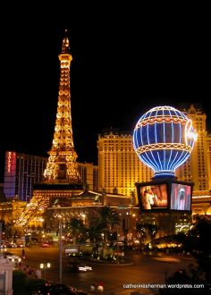 I took this photo on the Strip in Las Vegas, Nevada, in 2007, of the Eiffel Tower replica at Paris Las Vegas. I'm adding it at the request of a commenter, even though it's not in a town named Paris.