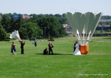 Brides and grooms love to get their photographs taken in front of one of the shuttlecocks at the Nelson-Atkins Museum of Art in Kansas City. A Kansas City Star photographer was shooting this bride and groom for a feature on the shuttlecocks when I took this photograph. They weren't the only wedding party there that day being photographed in front of a shuttlecock. There are four of these shuttlecock sculptures at the museum, designed by sculptors Claes Oldenburg and Coosje van Bruggen.