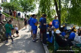 Members of the University of Kansas Jayhawk Dragon Boat Team wait for their race.