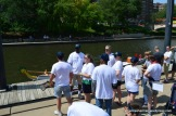 The Blazing Paddles dragon boat crew waits at the dock on Brush Creek.