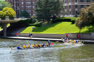 The two dragon boats make the turn in their race in the International Dragon Boat Festival on June 14, 2014, on Brush Creek in the Country Club Plaza in Kansas City, Missouri. Whoever is able to make the turn first has a great advantage.