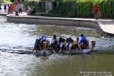 The two dragon boats nearly collide as they race to the buoy where they make the turn to the starting point.
