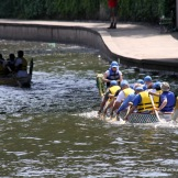 The second boat to make the turn has to paddle hard to beat the first boat in the International Dragon Boat Festival on June 14, 2014, on Brush Creek in the Country Club Plaza in Kansas City, Missouri.