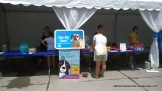 Visitors stop at the Wayside Waifs booth at Bark at the Park during the Kansas City Royals game on June 22, 2014.