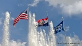 Flags fly and fountains play at Kauffman Stadium when the Kansas City Royals played the Seattle Mariners on June 22, 2014.