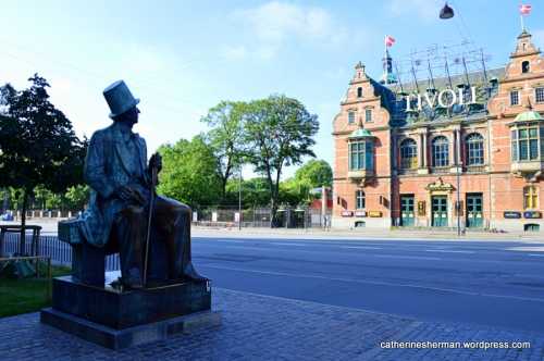 Hans Christian Andersen is depicted in a bronze sculpture staring at Tivoli Gardens amusement park in Copenhagen, Denmark. Both Andersen (1805-1875) and Tivoli, opened in 1843, were dedicated to the joy of children with just a little fear thrown in. My husband and I stayed at a hotel near the Tivoli and heard the screams of delighted children as they rode the rides.  Andersen's statue was very popular, and I had to wait a long time to take a photo when he was alone.  In his own life, Andersen had many friends and and a huge number of admirers, but never married or was in a romantic relationship.
