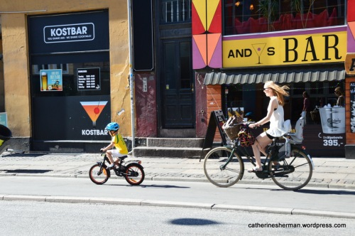 A mother and her son bike to the store together in Copenhagen, Denmark.