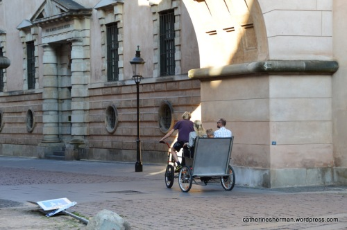 A pedicab enters an historic prison area at Slutterigade in Copenhagen.