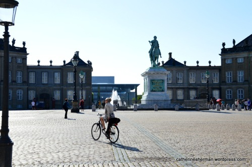 A biker crosses the courtyard of Amalienborg Palace, the winter residence of the Danish royal family. The equestrian statue is of Amalienborg's founder, King Frederick V.