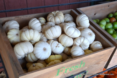 Mini white pumpkins and other produce are for sale at The Farmer's House in Weston, Missouri.