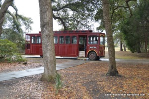 """Guests tour the Charleston Tea Plantation on one of two trolleys. This one was purchased from the Kentucky Derby city of Louisville, Kentucky, and still retains its name of """"Man of War,"""" a famous race horse."""
