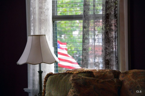 Flag Outside Window at Inn at 835, Springfield, Illinois.