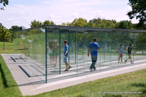 Visitors to the Donald J. Hall Sculpture Park make their way slowly through the Glass Labyrinth. The labyrinth is one of the many sculptures and art pieces on the grounds of the Nelson-Atkins Museum of Art, Kansas City, Missouri.