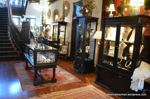 Beautiful cabinets that match the original woodwork of the old Webster School display jewelry for sale.