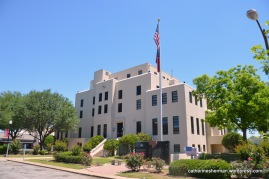 "The Titus County Courthouse was built in 1895, but currently looks nothing like its original brick exterior with a large bell tower on top. The building underwent several modernistic renovations, some of which earned it the title of ""Ugliest Courthouse in Texas,"" although there are other contenders. The building was restored to its 1940s Art Deco- Moderne appearance."